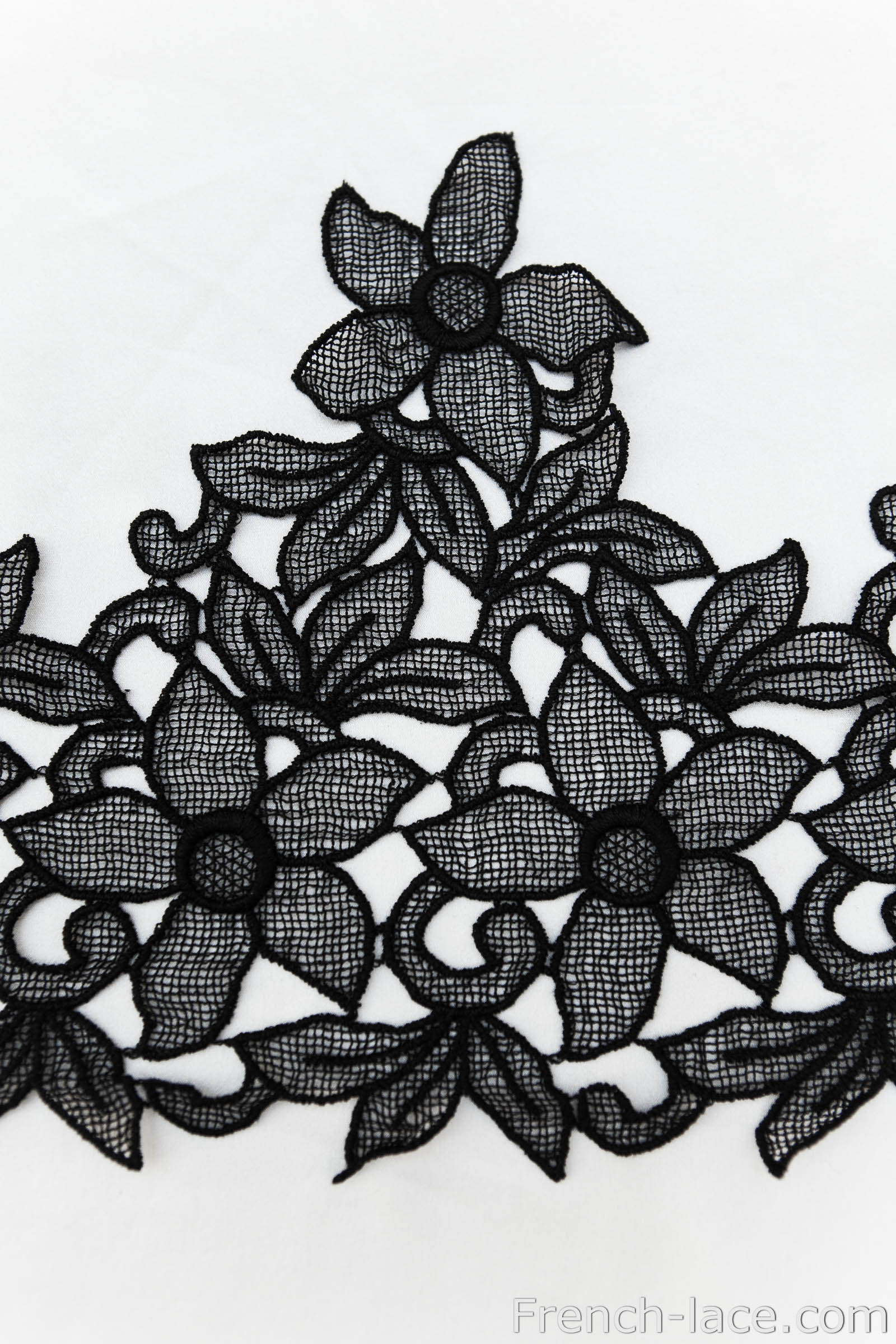 Black macrame lace, can be cut into appliques.