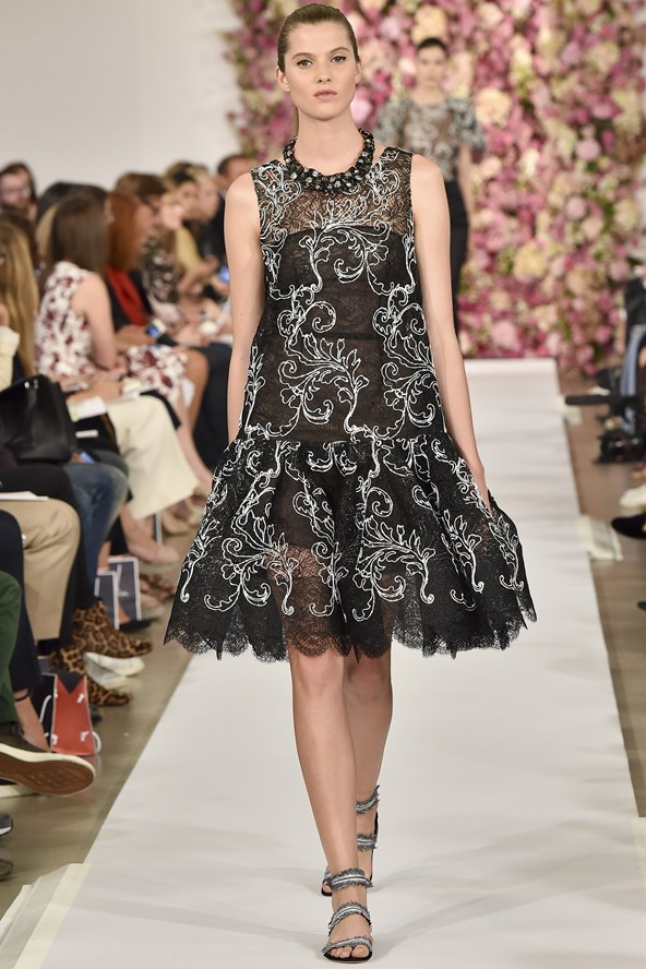 Perfect black lace dress with a contrast embroidery