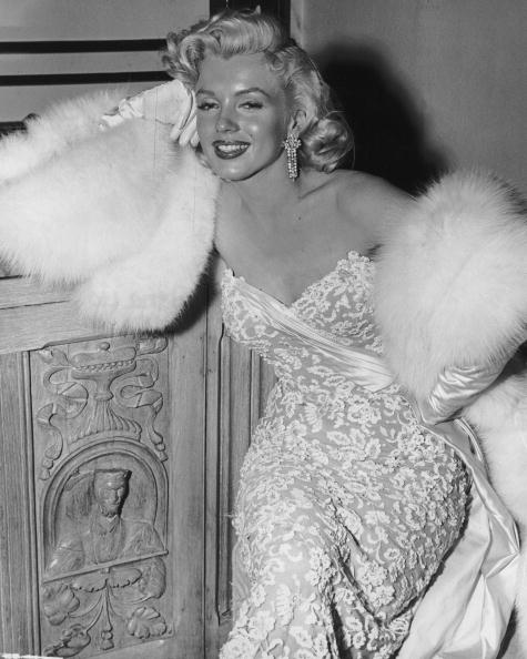 Marilyn Monroe wearing white fur wrap and strapless evening lace gown during a party for the film, 'How To Marry A Millionaire'. 1953. And yes this is the same Alexa lace!