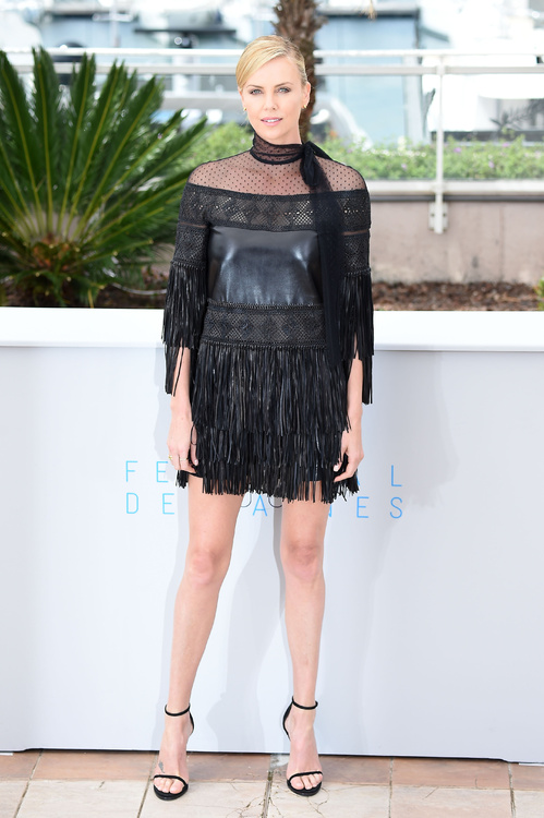 Charlize Theron in a black Valentino dress. Lace and leather!